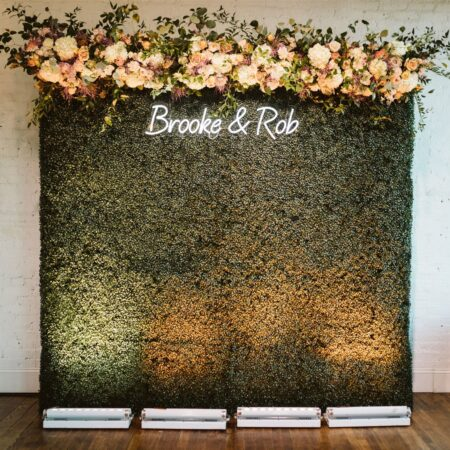 neon wedding sign floral backdrop