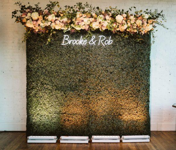neon wedding sign floral backdrop